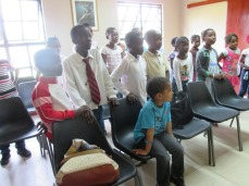 """Elder Schachterle is playing piano as the Primary learns """"Mae Te Amo"""""""