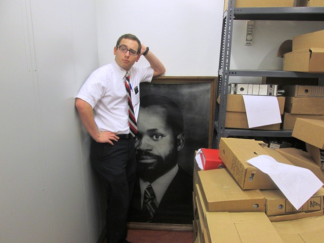 Zachary with a photo of Samora Machel, the first president of independent Mozambique